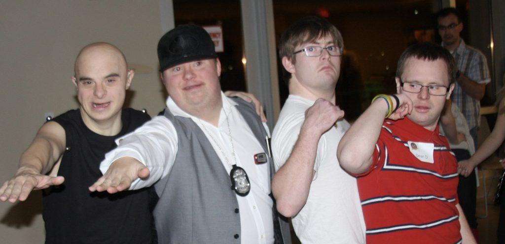 four guys posing graphic